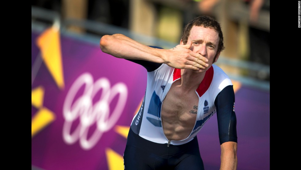 Britain's Bradley Wiggins celebrates after winning the men's individual time trial road cycling event.