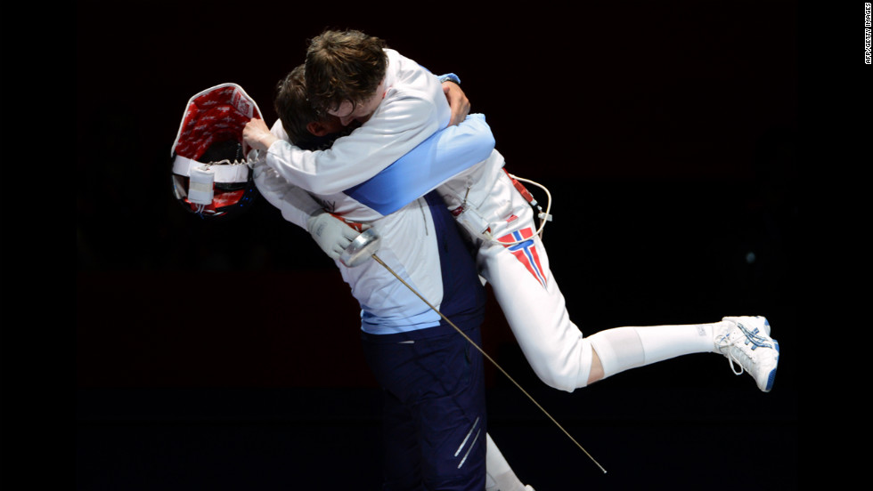 Norway's Bartosz Piasecki celebrates with his coach after beating South Korea's Jung Jinsun in the men's epee semifinal fencing bout.