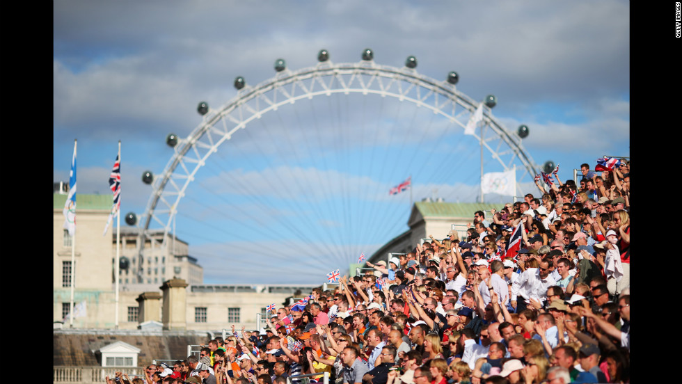 The London Eye peers down on the men's beach volleyball preliminary match between Great Britain and Norway.