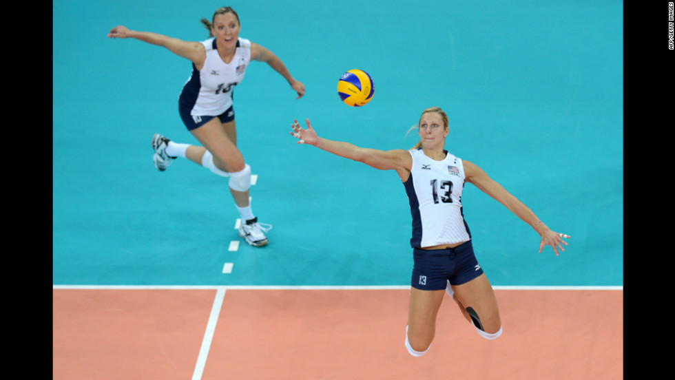 U.S. middle blocker Christa Harmotto, right, spikes during the women's preliminary volleyball match against China.