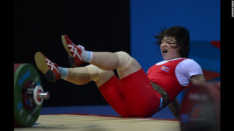 North Korea's Rim Jong Sim falls while competing in women's 69-kilogram weightlifting.