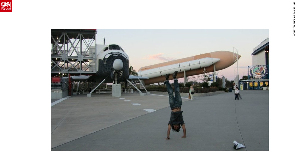 "Thomas Thomas Jr.'s travel shots are full of energy and enthusiasm. Here he does one of his classic handstands at <a href=""http://www.kennedyspacecenter.com/"" target=""_blank"">NASA's Kennedy Space Center</a> in Florida."