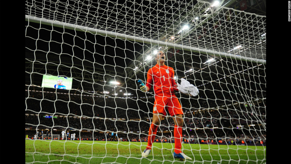 Great Britain's goalkeeper Jack Butland celebrates winning the men's football match against Uruguay in Cardiff, Wales.