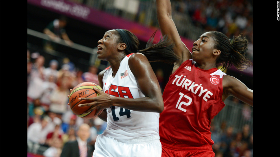 Center for the United States Tina Charles, left, vies with Turkey's Kuanitra Hollingsvorth during the women's preliminary round basketball match.