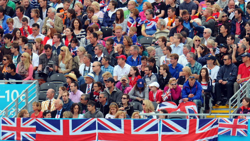 Great Britain fans watch and cheer during the men's single sculls semifinals Wednesday.