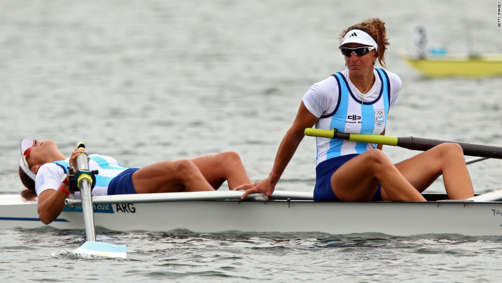 Maria Laura Abalo, left, and Gabriela Best of Argentina look on after finishing the women's pair B rowing finals Wednesday.