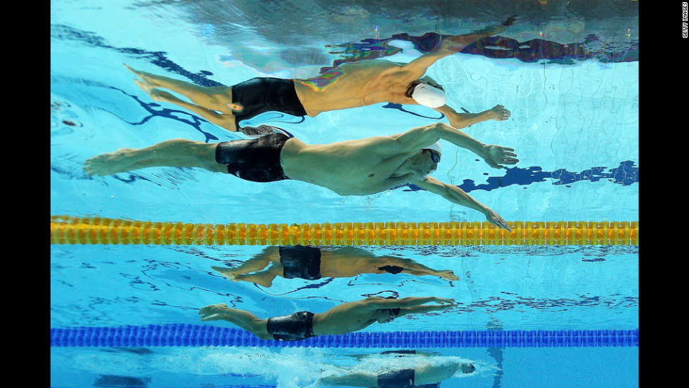 Michael Phelps of the United States, top, competes Wednesday in the men's 200-meter individual medley.