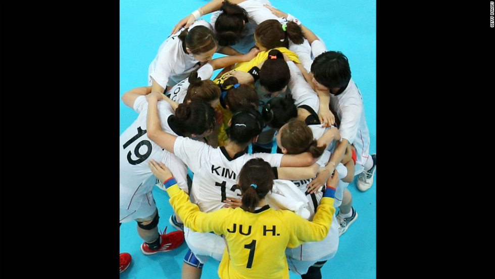 Korean players huddle after tying with Norway in a women's preliminary handball match Wednesday.