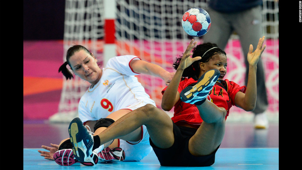Montenegro's center back Ana Radovic, left, vies with Angola's Natalia Bernardo during the women's preliminary handball match Wednesday.