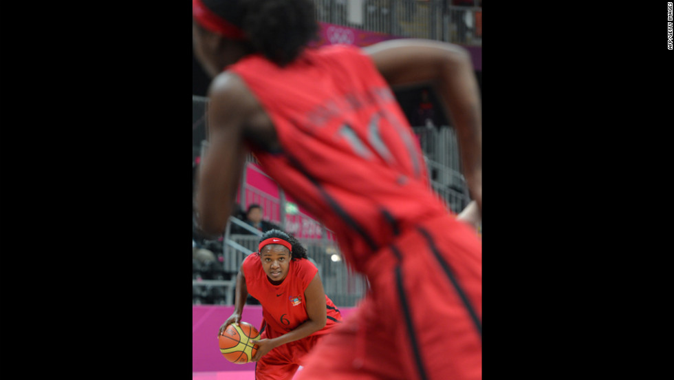 Angolan forward Felizarda Jorge looks to pass Wednesday during the preliminary round basketball game against China.