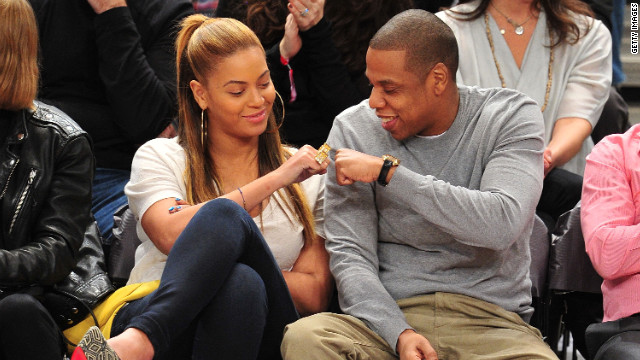 Jay-Z and his wife, Beyonce, celebrate at a Nets-Knicks game in February in New York.