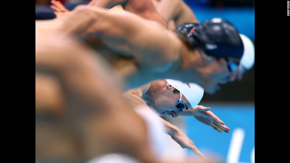 Australia's James Magnussen dives in the water at the start of the men's 100-meter freestyle.