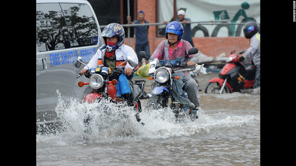 Motorists make their way through Manila's flooded streets Wednesday.