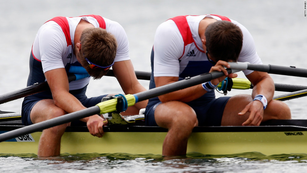 Britain's Bill Lucas and Sam Townsend appear downcast after finishing the men's double sculls final.