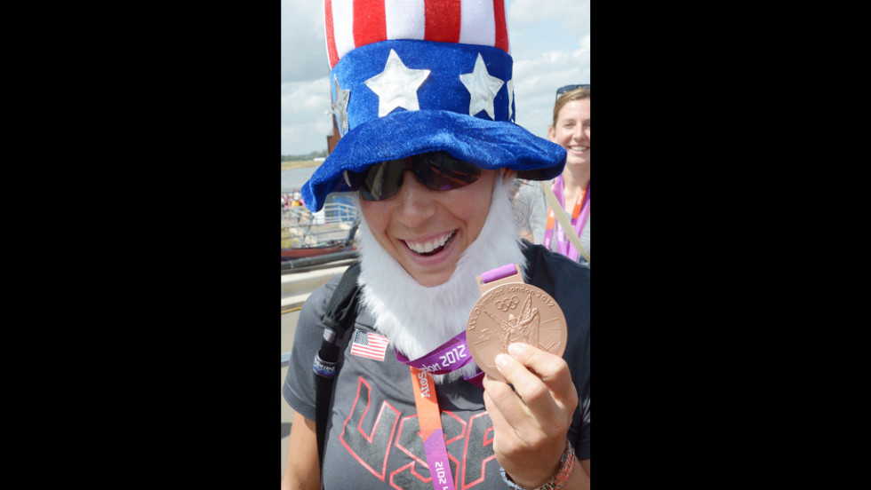A member of the U.S. team wears an Uncle Sam getup after she and her teammates won the gold medal in the women's eight rowing final.