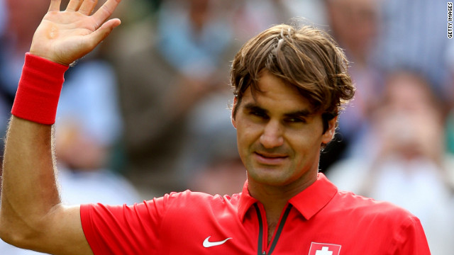 Roger Federer celebrates his straight sets victory over John Isner in the Olympic men's singles quarterfinals.