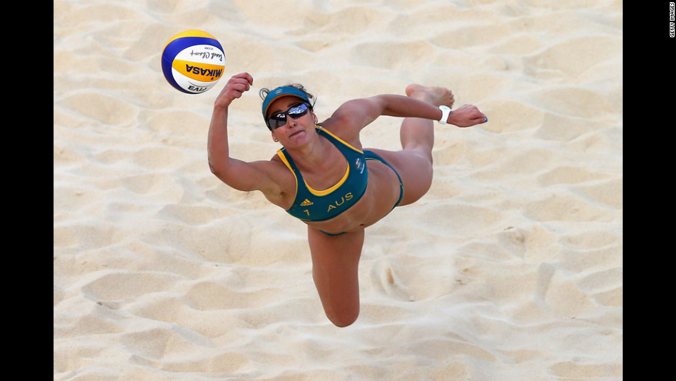Australia's Becchara Palmer dives for the ball during the women's beach volleyball preliminary match against Brazil.