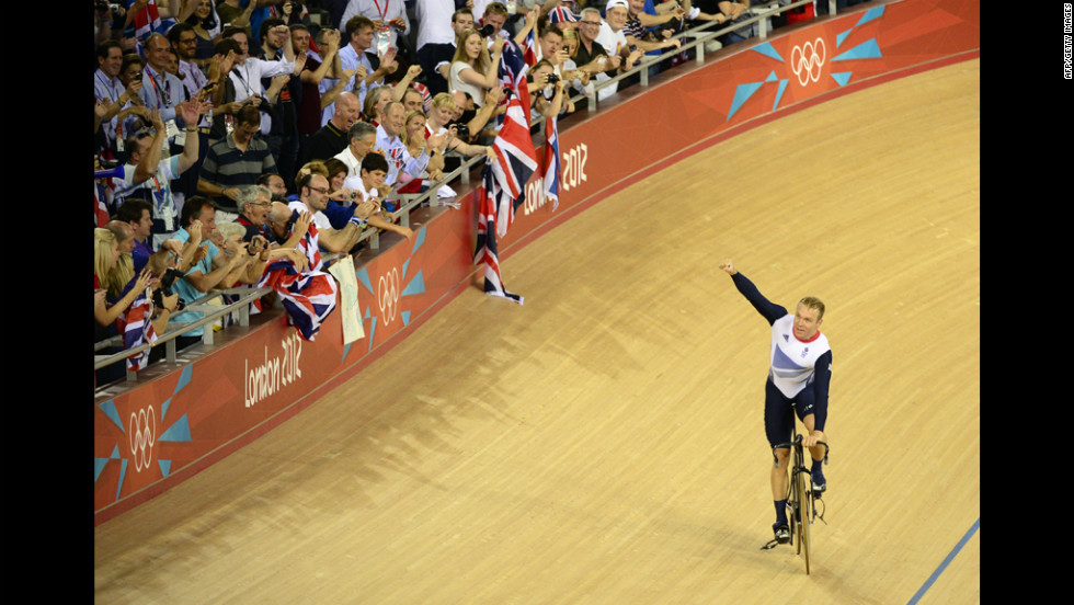 Great Britain's Chris Hoy celebrates after winning the men's team sprint gold final.