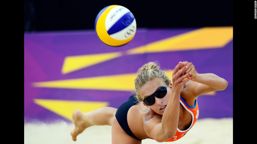 Sophie van Gestel of the Netherlands controls the ball during the women's beach volleyball preliminary phase group E match against Germany's Laura Ludwig and Sara Goller.