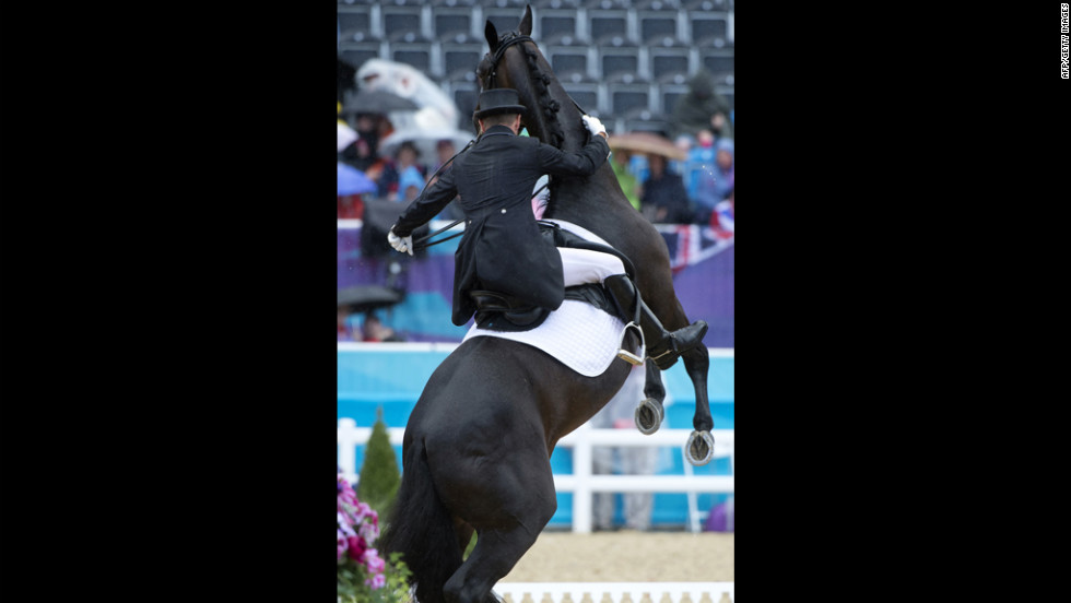 Canada's Marcus David loses control of his horse, Capital, in the dressage preliminaries.