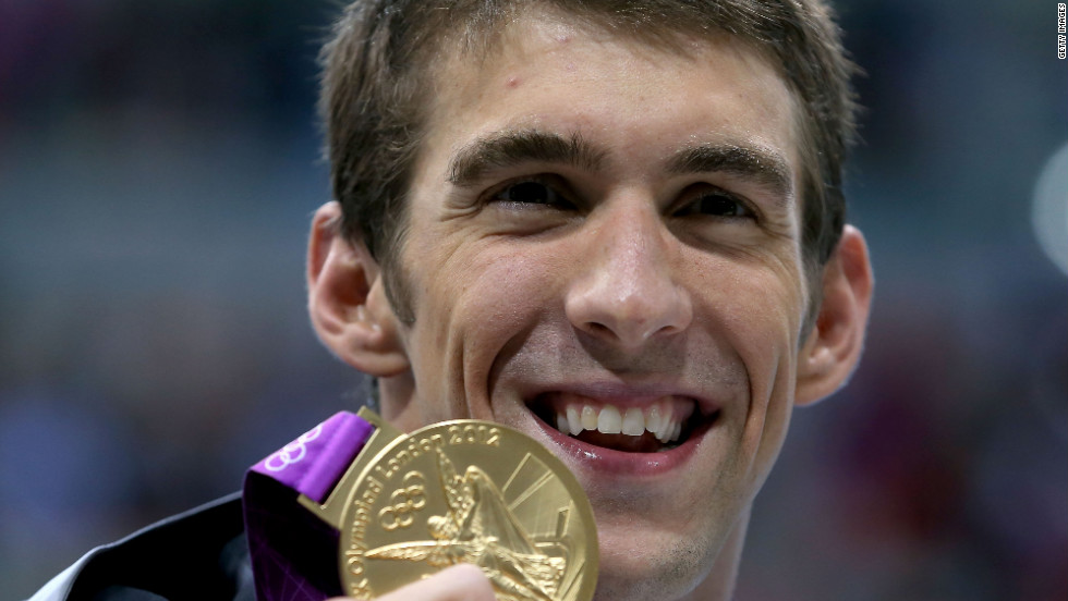 Michael Phelps shows off his gold medal from the 200-meter Individual medley at the London Olympics on Thursday, August 2. It was his 20th career medal.