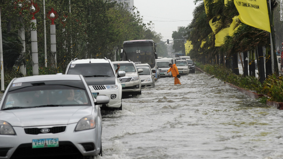 Motorists drive through floodwaters along Manila's Roxas Boulevard in Manila on Wednesday.
