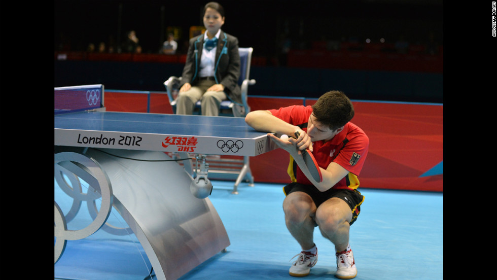 Dimitrij Ovtcharov of Germany serves during a men's table-tennis singles semifinal match.