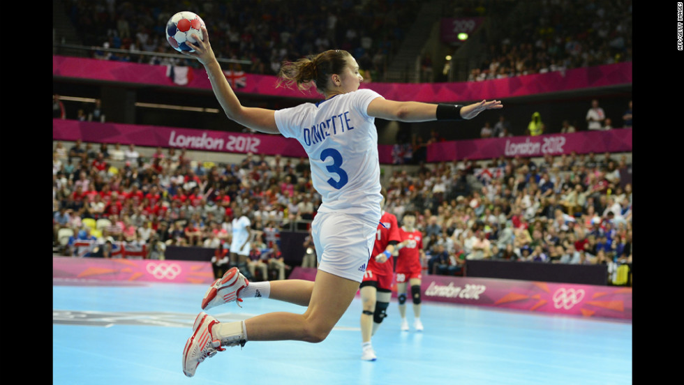 France's Blandine Dancette jumps to shoot during a women's preliminary handball match between South Korea and France.