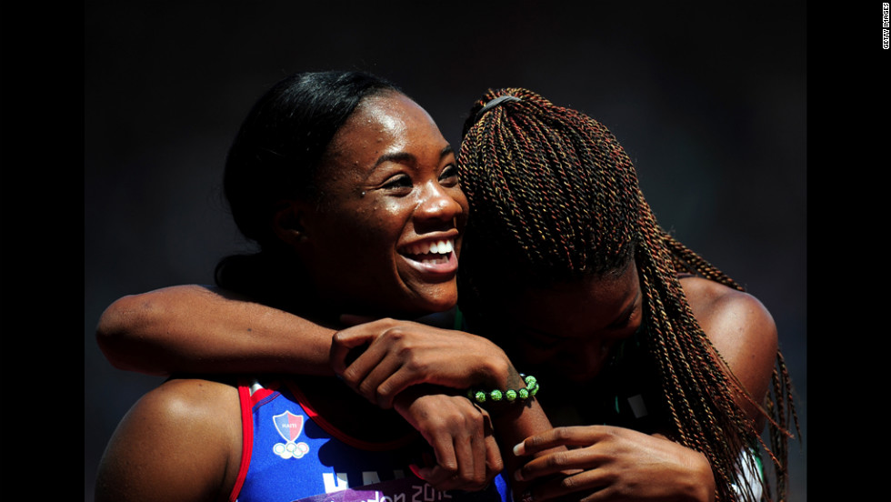 Marlena Wesh of Haiti rejoices after competing in the women's 400-meter heats.