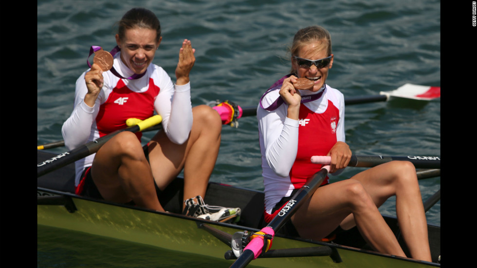 Bronze medalists Magdalena Fularczyk, left, and Julia Michalska of Poland celebrate their medals during the ceremony for the women's double sculls final.