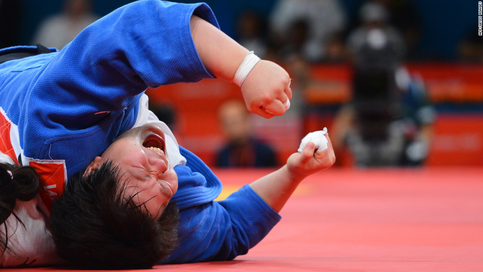 China's Tong Wen celebrates her victory in the women's over 78-kilogram judo bronze medal match.
