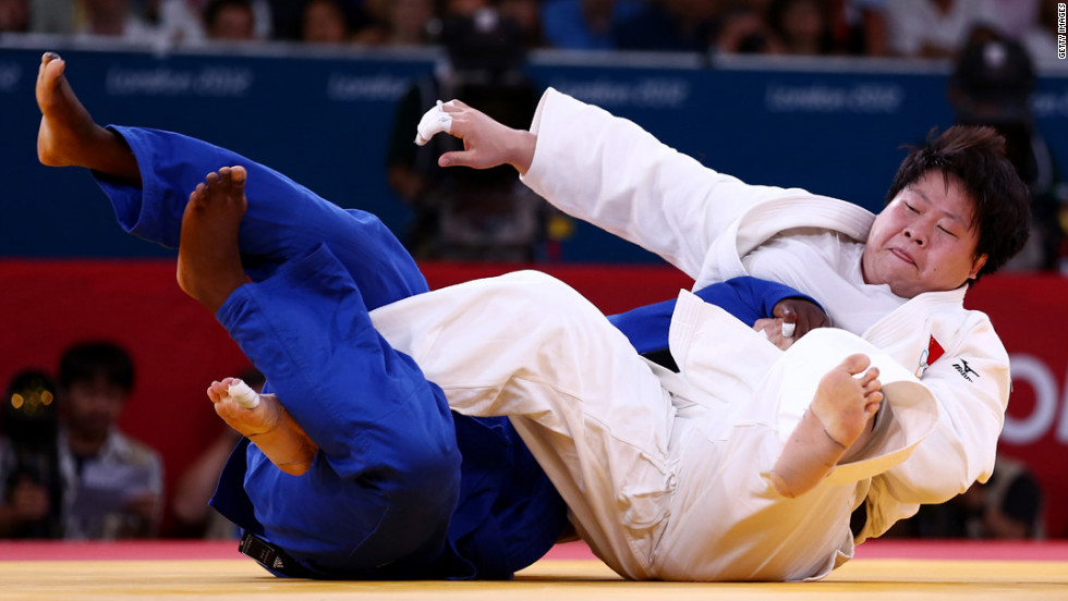 China's Wen Tong, in white, and Idalys Ortiz of Cuba compete in the women's over 78-kilogram judo event.
