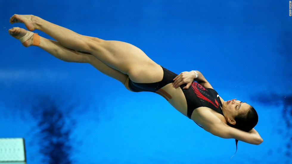 Minxia Wu of China competes in the women's 3-meter springboard diving preliminary round.