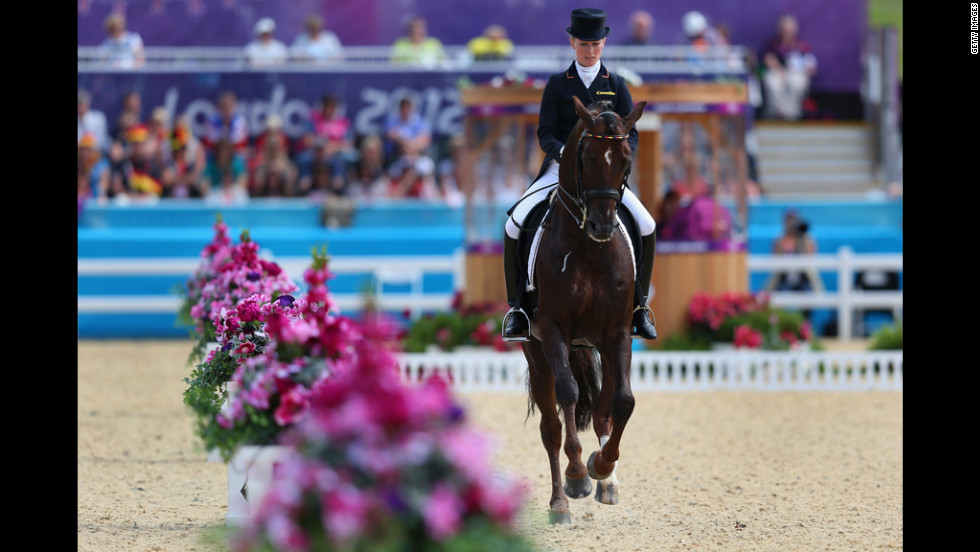 Helen Langehanenberg of Germany rides Damon Hill in the dressage grand prix.