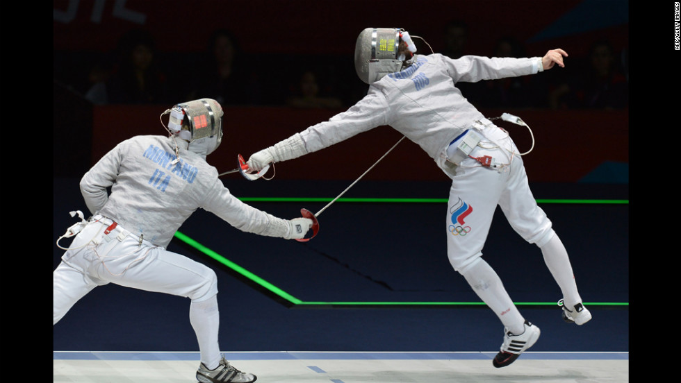 Italy's Aldo Montano, left, fences against Russia's Alexey Yakimenko during the men's sabre bronze medal match as part of the fencing event on Friday.