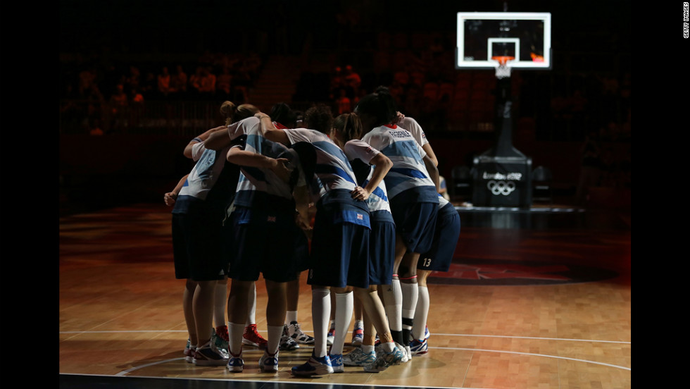 Great Britain huddles up before the women's basketball preliminary round match against France on Friday.