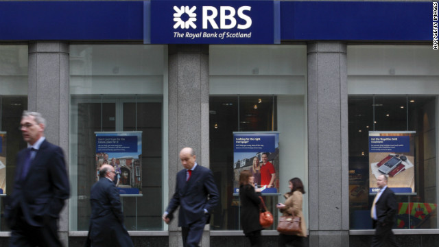 Pedestrians walk past a branch of the Royal Bank of Scotland in London on January 30, 2012.