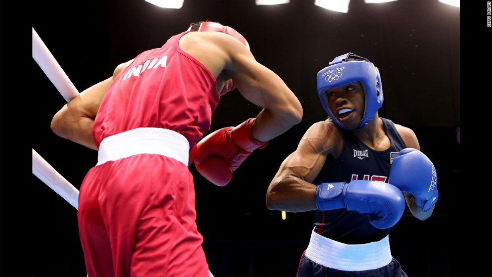 Krishan Vikas of India, left, in action with Errol Spence of United States, right, during the men's welter (69 kilogram) boxing match.