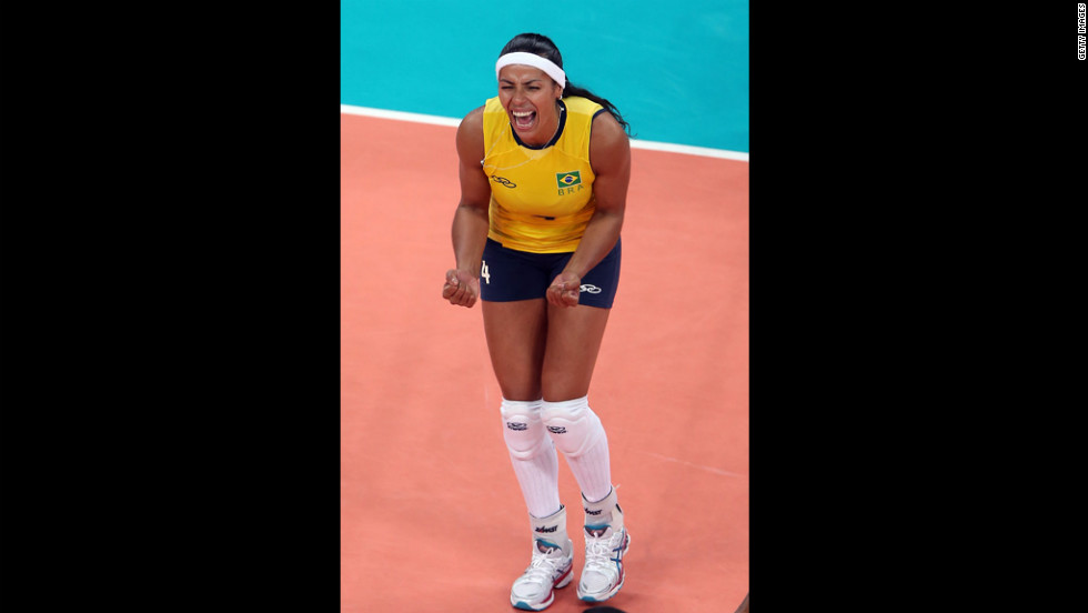 Paula Pequeno of Brazil celebrates a point in the first set against China during women's volleyball.