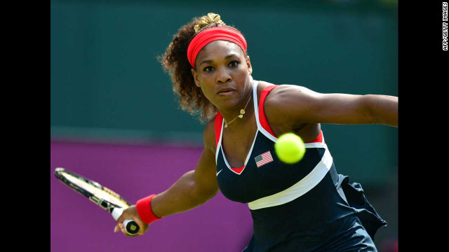 Serena Williams hits a return to Russia's Maria Sharapova during the women's singles tennis final on Saturday, August 4.