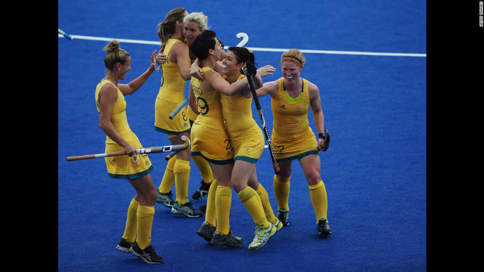 The Australian women's hockey team celebrates during a preliminary round group B match against South Africa.