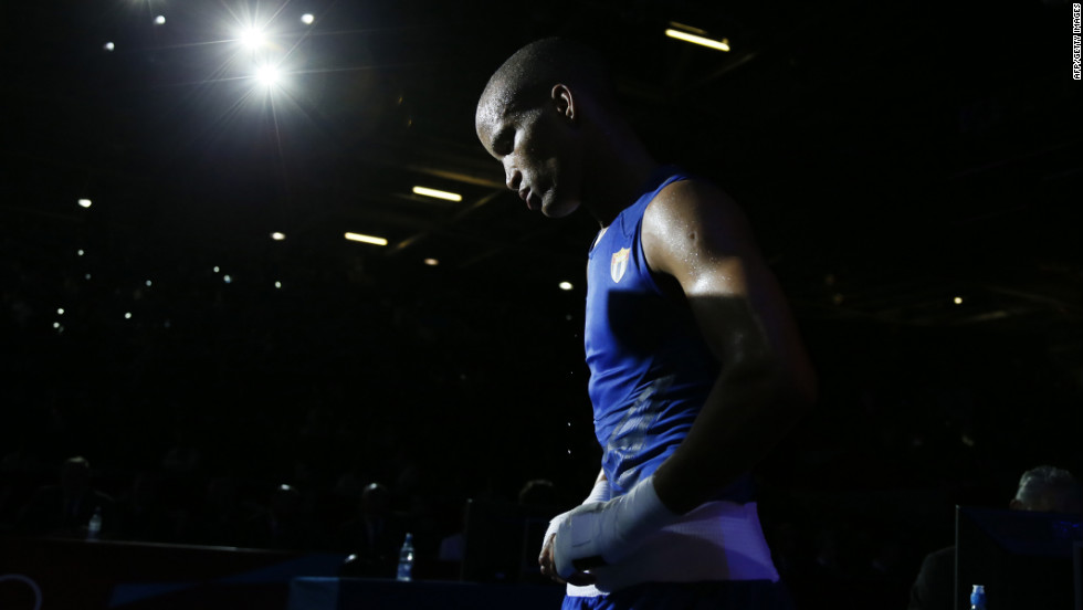 Roniel Iglesias Sotolongo of Cuba departs the ring after defeating Everton dos Santos Lopes of Brazil in a light-welterweight (64 kilogram) match. Iglesias Sotolongo was awarded an 18-15 points decision, sending him to the quarterfinals.