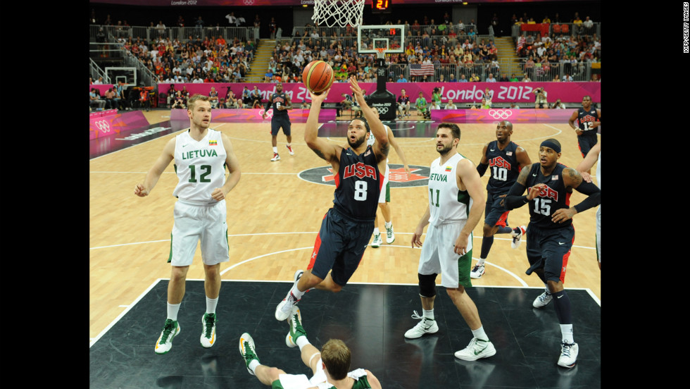 The United States' Deron Williams shoots during a men's basketball preliminary round match against Lithuania.