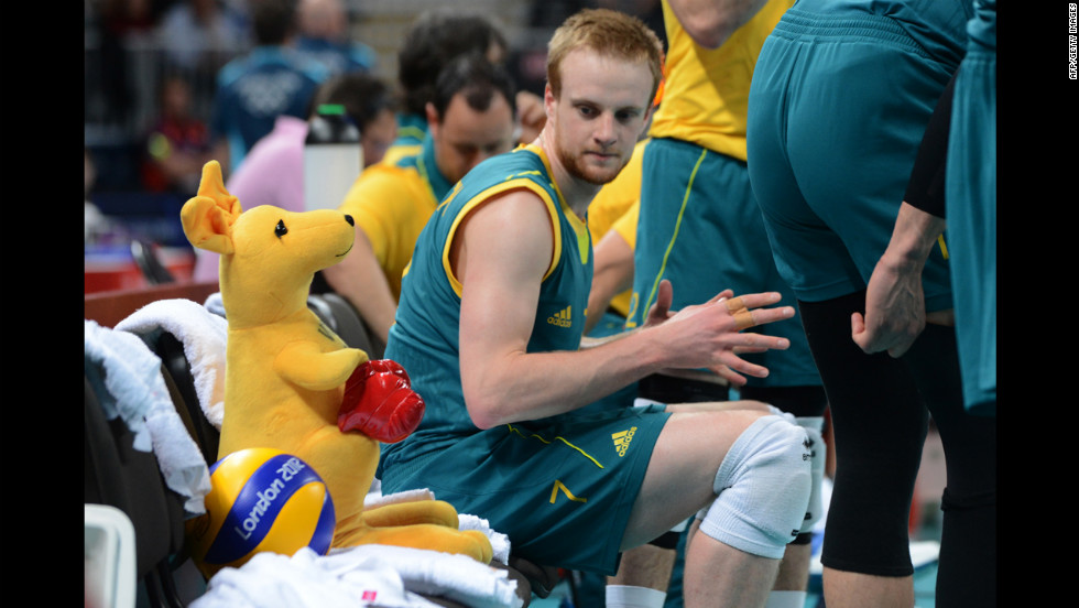 Australia's Harrison Peacock listens to his coach during a volleyball match.
