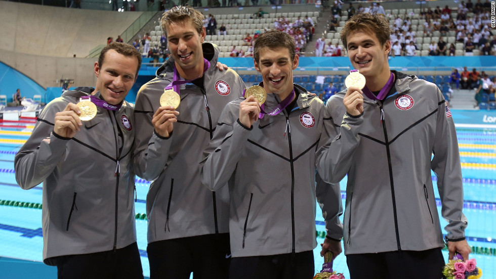 Left to right: Brendan Hansen, Matthew Grevers, Michael Phelps and Nathan Adrian pose following the medal ceremony for the men's 4x100-meter medley on Saturday, August 4.