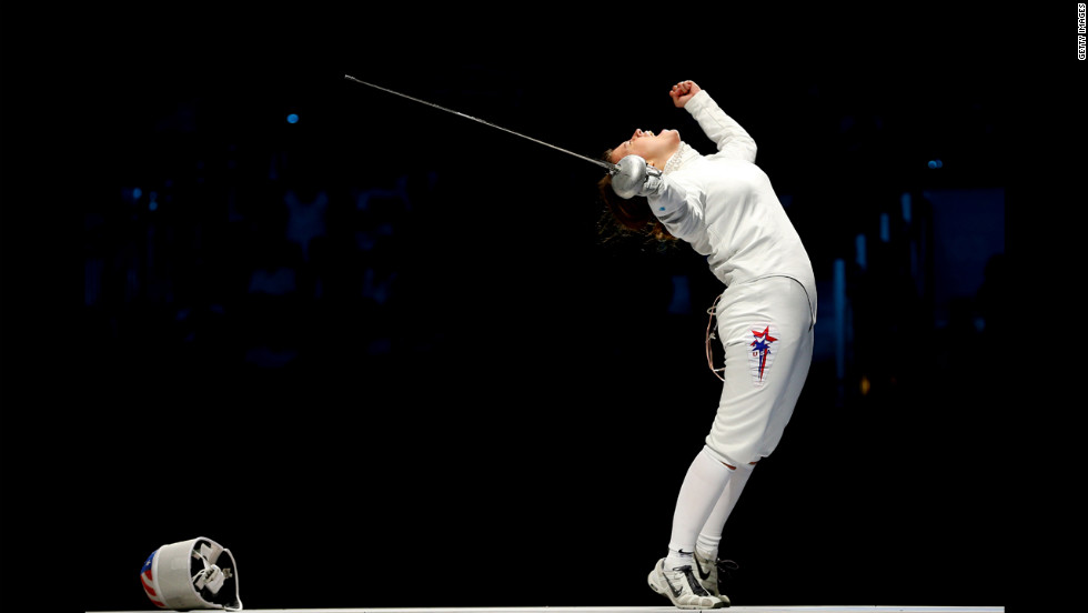 Courtney Hurley of the United States celebrates after she and her teammates defeated Russia in the the bronze medal match, 31-30, in women's epee team fencing.