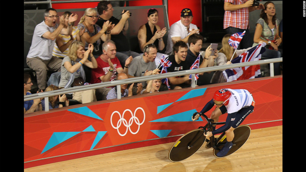 Jason Kenny of Great Britain is cheered on by spectators as he sets a new Olympic record during the men's sprint track cycling qualifying event.