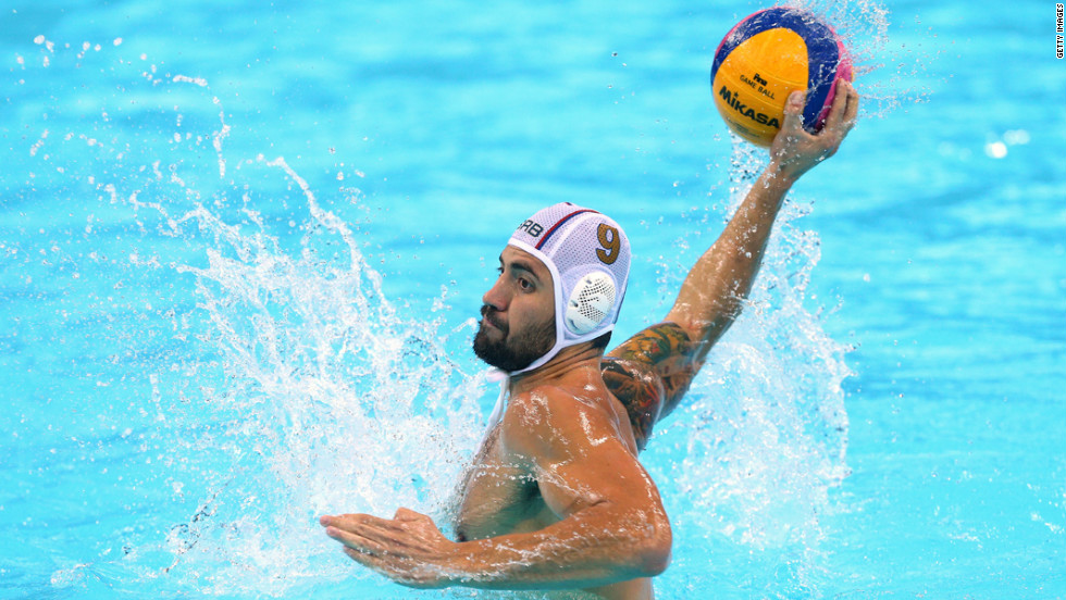 Nikola Raden of Serbia takes a shot at goal during a men's preliminary round water polo match against the United States.