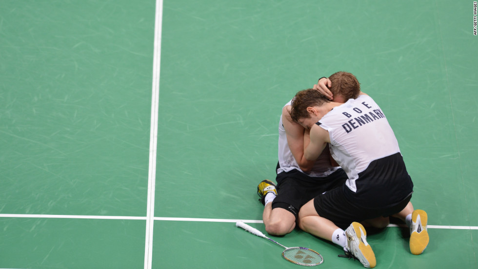 "Denmark's Mathias Boe and Carsten Mogensen celebrate their victory over Chung Jae Sung and Lee Yong Dae of South Korea during the semifinal men's doubles badminton match. Check out photos from<a href=""http://www.cnn.com/2012/08/05/worldsport/gallery/olympics-day-9/index.html"" target=""_blank""> Day 9 of the competition </a>on Sunday, August 5."
