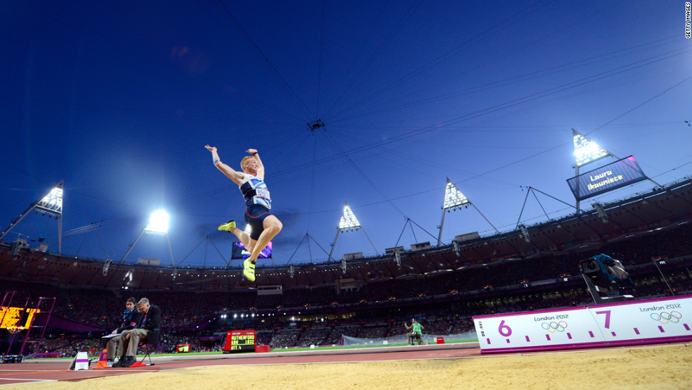 Greg Rutherford of Great Britain on his way to winning the gold medal in the men's long jump final.